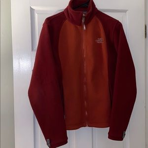 Rust red and burgundy north face jacket